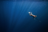 A Bajo Elder of Sampela, Spear Fishing on the Reef Photographic Print by Cory Richards