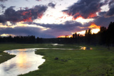 The Sun Setting over the Gibbon River, Meadows, and Evergreen Forests in Yellowstone National Park Photographic Print by Robbie George