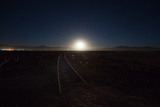 The Moon Rises over a Dead Train Line in Uyuni Photographic Print by Alex Saberi