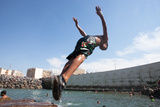 In Casablanca, a Teenage Boy Dives into a Natural Pool Formed by the City's Break-Wall Fotografisk tryk af Eric Kruszewski