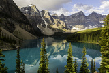 Reflections of Rugged Mountains and Evergreen Trees in a Mountain Lake Photographic Print by Jonathan Irish