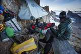 Expedition Team Members Try to Stay Warm on a Ledge of Bertha's Tower,1,200 Feet Above the Ground Photographic Print by Cory Richards
