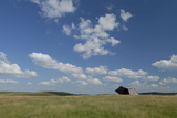 An Abandoned Barn in a Vast Field under a Sky with Puffy Clouds Photographic Print by Michael Forsberg