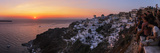 Sunset over the Aegean Sea Seen from a Cliff-Top Town on Santorini Island Fotografisk tryk af Babak Tafreshi