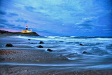 The Montauk Point Lighthouse Shining at Dusk Stampa fotografica di Robbie George