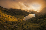 An Alpine Pond Enveloped by a Cloud at Sunset Photographic Print by Michael Melford