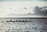 Men Paddle an Outrigger Canoe Off Tahiti Island, with Moorea Island in the Background Photographic Print by Andy Bardon