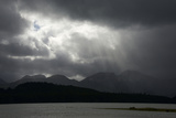 Sunlight Through Heavy Clouds over Mountains and Water Photographic Print by Bob Smith