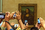 A Crowd of Tourists Photographing the Mona Lisa Portrait at the Louvre Museum Photographic Print by Babak Tafreshi