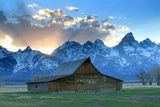 At Sunset, the Teton Range Rises Behind a Historic Barn on Mormon Row Photographic Print by Robbie George