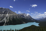 A View of Rugged Mountains and Evergreen Forests around the Turquoise Waters of Moraine Lake Photographic Print by Jonathan Irish