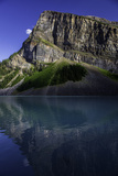 A Rugged Mountain Reflected in the Turquoise Waters of Lake Louise Photographic Print by Jonathan Irish