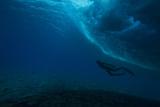 A Man Swimming under the Waves at Teahupoo, Tahiti Photographic Print by Andy Bardon