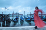A Pregnant Woman in a Flowing Red Dress and Scarf Standing Next to Docked Gondolas Photographic Print by Joe Petersburger