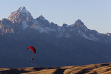 A Paraglider Soars Above Grand Teton National Park Photographic Print by Steve Winter