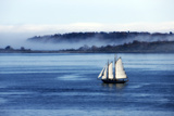A Sailboat Cruising Casco Bay on a Foggy Morning Photographic Print by Robbie George