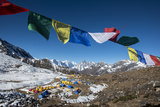 Ama Dablam Base Camp in the Everest Region of Nepal under a String of Prayer Flags Photographic Print by Alex Treadway