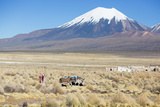 A Farmer Crosses a Landscape Below a Volcano in Sajama National Park Photographic Print by Alex Saberi