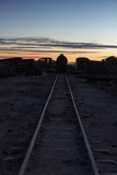 Sunset at the Train Graveyard in Uyuni, Bolivia Photographic Print by Alex Saberi