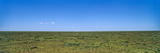 The Vast and Featureless Short Grass Savannah Plain Beneath a Clear Blue Sky Photographic Print by Jason Edwards