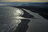 The Waiatoto River Breaks Through a Gravel Bulwark to Meet the Tasman Sea Photographic Print by Michael Melford