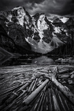 A Jam of Logs in a Lake Bounded by Snowy Mountains Photographic Print by Jonathan Irish