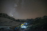 Ama Dablam Base Camp in the Everest Region Glows under Stars with the Milky Way Photographic Print by Alex Treadway