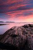 A Man Fishing Off of the Rocky Coast of Maine at Sunset Photographic Print by Robbie George