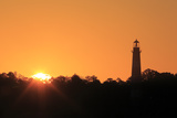 The Sun Rising Next to the Assateague Lighthouse Photographic Print by Robbie George