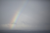 A Rainbow over the Serene Open Ocean Photographic Print by Andy Bardon