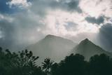 Cloud Shrouded Mountains Above Teahupoo Photographic Print by Andy Bardon