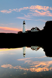 The Portland Head Light and its Reflection in Water, as the Sun Sets on Casco Bay Photographic Print by Robbie George