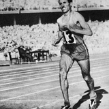 Alain Mimoun Running Through the Stadium to Win the Gold Medal at the Melbourne Olympics in 1956 Photographic Print by Bernardo Buontalenti