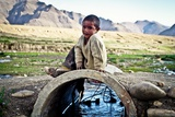 Boy on the Stream Tibet, 2011 Photographic Print by Shaun Taylor McManus