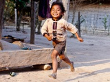 The Running Girl Laos, 2011 Photographic Print by Shaun Taylor McManus