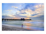 Girl in front of the Pier on the Beach of Naples on the Gulf Coast, Florida, USA Posters