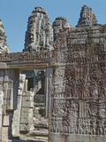 View of a Wall of the Temple of Bayon with Carved Reliefs Photographic Print by  Cambodian