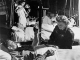 A Voluntary Nurse Taking a Patient's Pulse in a Military Hospital During World War Two Photographic Print