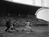 Pee Wee Reese Bats for the Brooklyn Dodgers During a Dodgers-Braves Game at Miami Stadium Photographic Print
