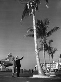 A Pan American Pilot and Flight Attendant the Edge of the Tarmac at Miami International Airport Photographic Print