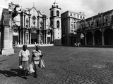 Two Women Stroll across Old Cathedral Plaza with Shopping Bags, Havana, 1977 Photographic Print