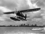 U.S. Water Ski Champion Bruce Parker Being Towed by a Seaplane across Biscayne Bay, 1946 Stampa fotografica