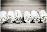 Dated Wine Bottle Corks On The Wooden Background Posters