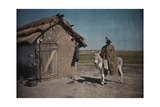 A Swineherd with Fur Cape Sits on a Donkey Outside a Thatched Hut Photographic Print by Hans Hildenbrand