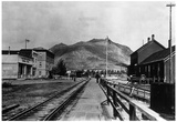 Yukon View of Town and Railroad - Carcross, AK Poster