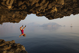A Climber Takes a Plunge While Deepwater Soloing Photographic Print by Jimmy Chin