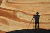 The Shadow of a Photographer on an Eroded Sandstone Formation Photographic Print by Greg Winston
