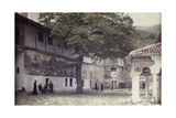 Murals Adorn Courtyard of Batchkovo Monastery; Monks Relax Outside Photographic Print by Wilhelm Tobien