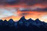Snowy Peaks in the Teton Range Outlined by an Orange Sky at Sunset Photographic Print by Robbie George