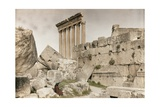 A Woman Sits Amongst the Massive Stones of Baalbek Ruins Photographic Print by Maynard Owen Williams